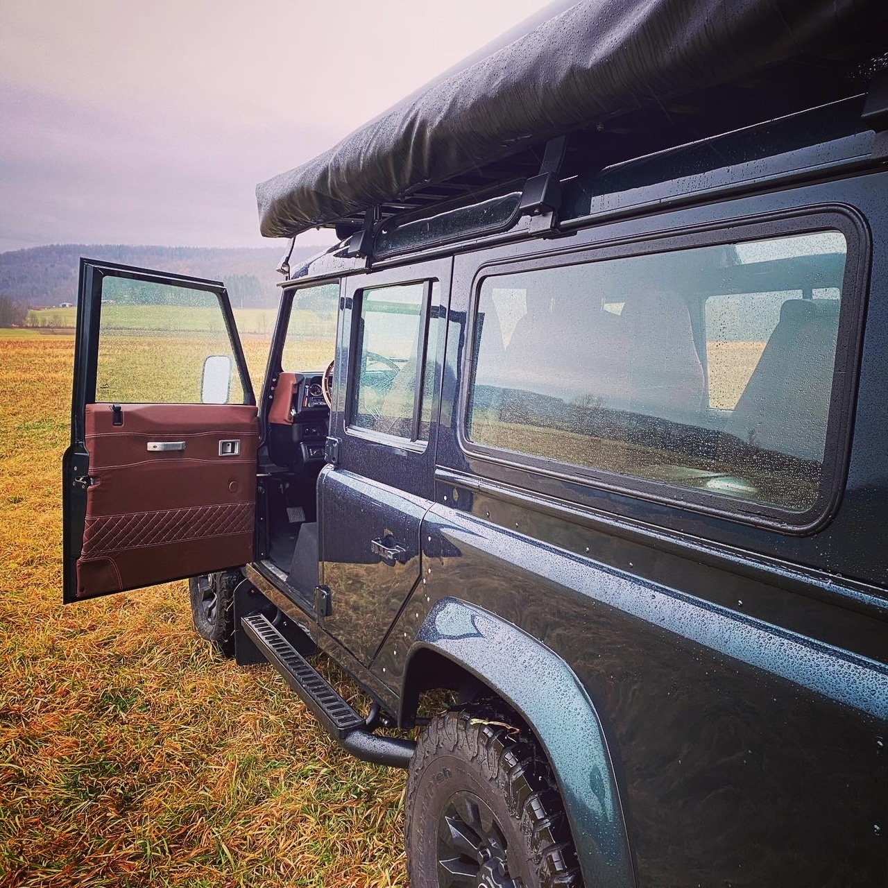 Driving a Defender is much like driving a Mercedes G Wagon or a Jeep except the Defender feels more stable. Send this image to a friend and tell them you want to visit the Helderburg Farm to see a Defender in person. Tent and Roof rack not included.