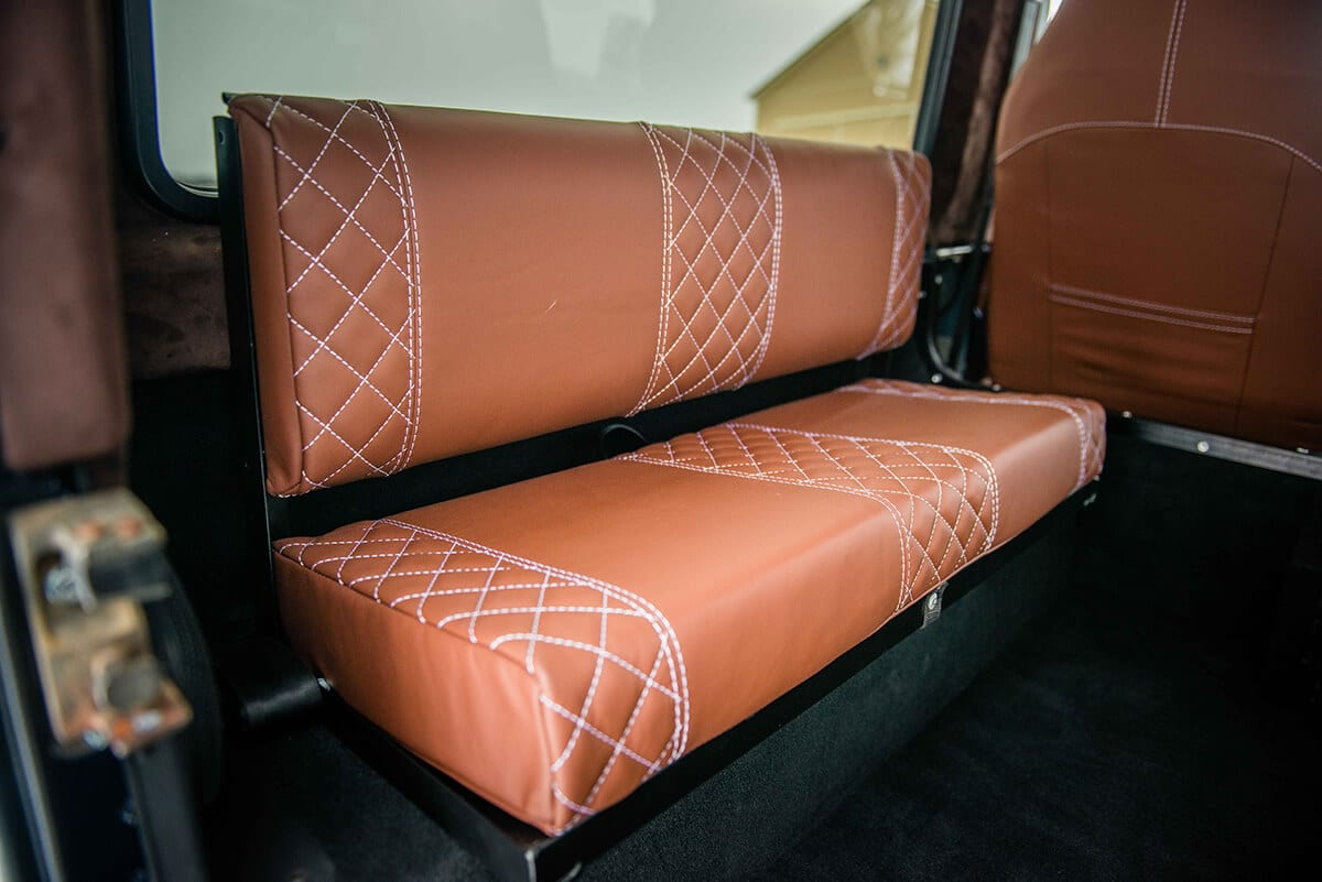 Land Rover Defender D90: Bespoke Leather Chestnut seat with contrast white stitch and quilted pattern