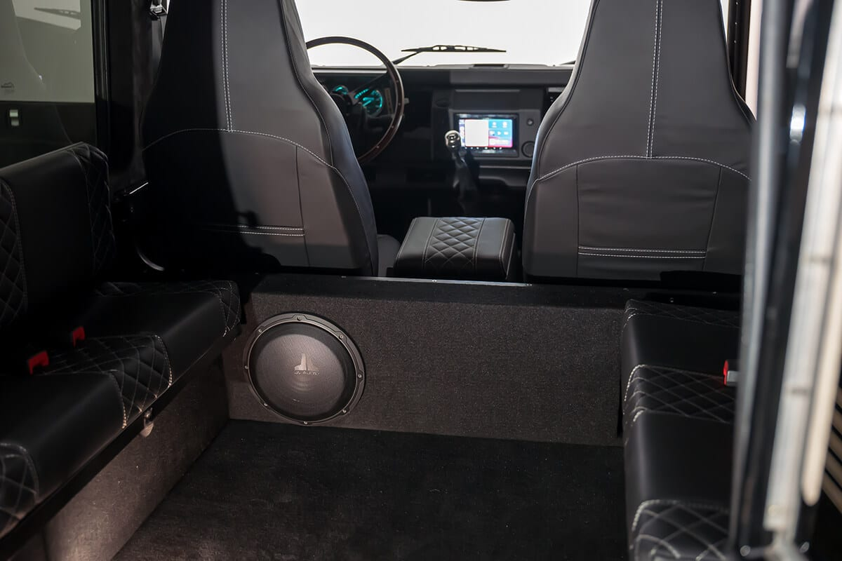"""Bespoke designed and built custom sub-woofer box that matches the styling of the Defender. 8"""" JL Audio Subwoofer for full sound"""