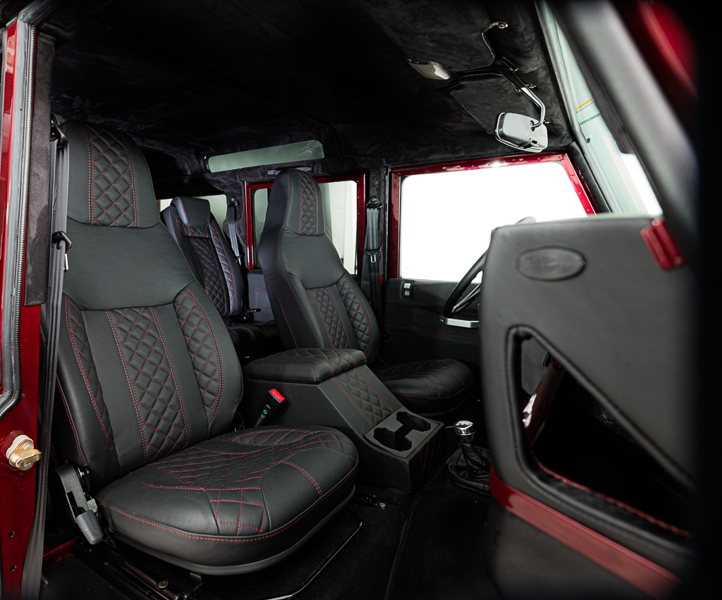 Bespoke Full Grain Leather Interior that Tanned in Scotland and Hand Stitched in England. Authentic English Wilton Wool Carpeting is an Option.