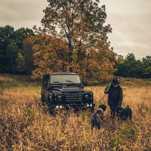 Paul with dogs and Defender